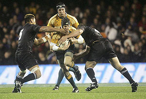 Stephen Larkham is tackled - AAP Image/Photosport