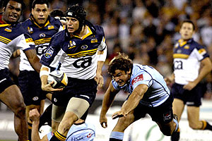 Brumbies Stephen Larkham looks for support - AAP Image/Alan Porritt