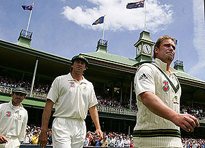 Shane Warne, Glenn McGrath and Justin Langer walk out onto the ground - AAP Image/Jenny Evans