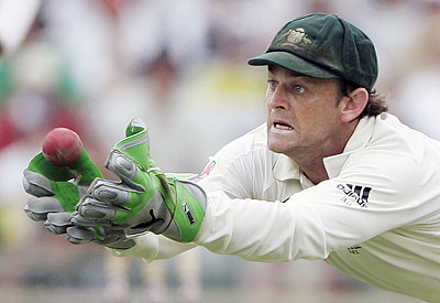 Australia's Adam Gilchrist stretches to catch out India's Mahendra Dhoni - AP Photo/Rick Rycroft