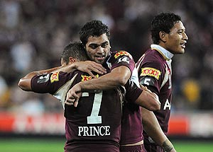 Queenslanders Scott Prince (left) and Karmichael Hunt (centre) embrace after the final whistle of the NRL State of Origin match between Queensland and New South Wales at Suncorp Stadium in Brisbane, Wednesday, June 11, 2008. AAP Image/Dave Hunt