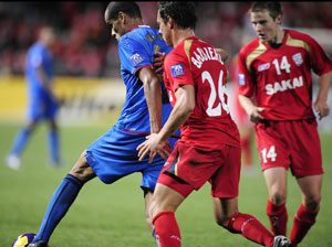 Uzbekistan's Bunyodkor's Rivaldo, left, is charged by Adelaide United's Giuseppe Barbiero (26) during their AFC Champions League semifinal soccer match Wednesday, Oct. 8, 2008 at Hindmarsh Stadium, Adelaide, Australia. Adelaide United won 3-0. AP Photo/David Mariuz