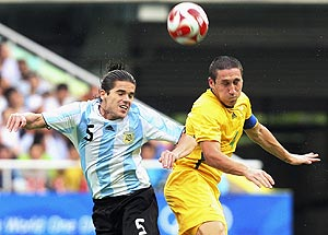 Argentina's midfielder Fernando Gago, left, and Australia's defender Mark Milligan, right, battle for a head ball during a group A first round men's soccer match at the Beijing 2008 Olympics in Shanghai, Sunday, Aug. 10, 2008. AP Photo/Eugene Hoshiko