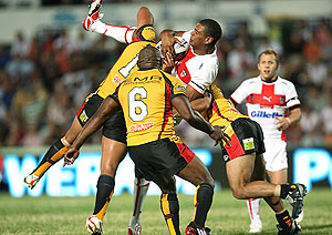 Leon Pryce is lifted in the tackle during the International Rugby League World Cup match, England v Papua New Guinea. AAP Image/Action Photographics, Colin Whelan