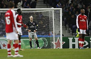 Arsenal's players react after the oppening goal from FC Porto's Bruno Alves (not seen) during their Group G Champions League soccer match at the Dragao stadium in Porto, Portugal, Wednesday Dec. 10, 2008. AP Photo/Paulo Duarte
