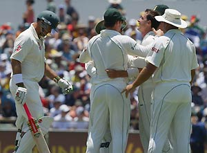 South African Dale Steyn (centre right) celebrates the wicket of Matthew Hayden (left) caught and bowled for four during the third day of their Test match against Australia at the WACA ground in Perth, Friday, Dec. 19, 2008. AAP Image/Tony McDonough
