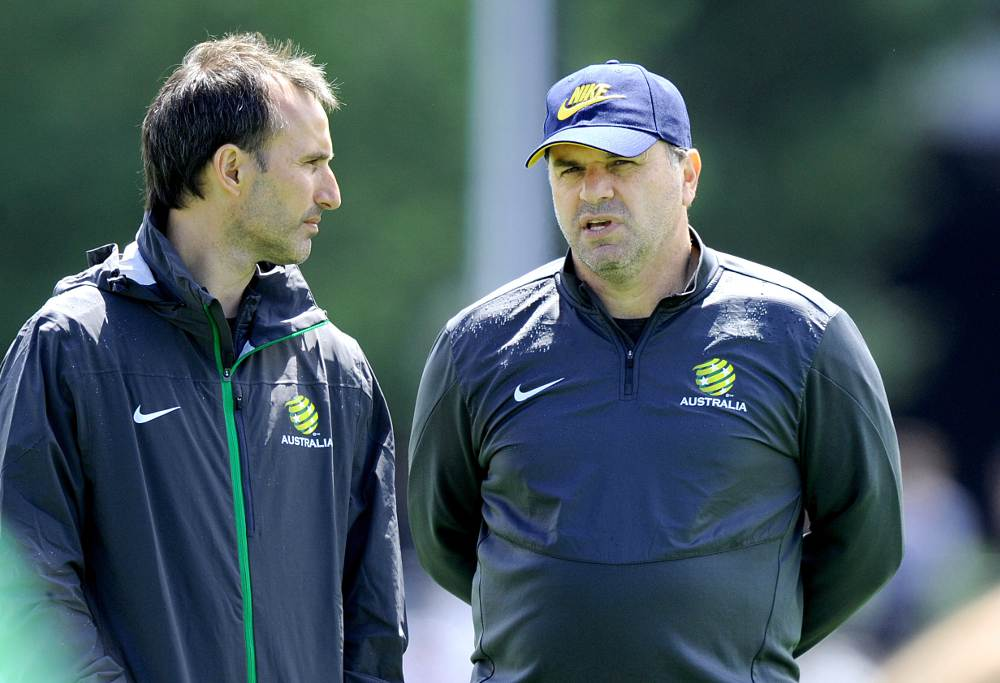 Socceroos Head Coach Ange Postecoglou (right) chats with assistant coach Aurelio Vidmar