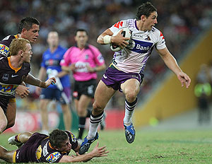 Storm player Billy Slater skips away from Andrew McCullough during the Rugby League, NRL Round 2, Brisbane Broncos v Melbourne Storm at Suncorp Stadium, Friday March 20, 2009. Broncos won 16 - 14. (AAP Image/Action Photographics, Colin Whelan)