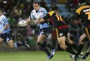 Fourie du Preez is tackled