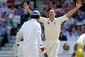 Australia's Mitchell Johnson, right, celebrates after taking the wicket of England's Graham Onions on the third day of the fourth cricket test match between England and Australia, at Headingley cricket ground in Leeds, England, Sunday, Aug. 9, 2009. (AP Photo/Tim Hales)