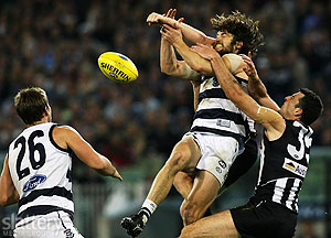 Geelong's Max Rooke attempts to mark against Collingwood's Simon Prestigiacomo (R) and Heath Shaw during the AFL 2nd Preliminary Final between the Geelong Cats and the Collingwood Magpies at the MCG. The Slattery Media Group