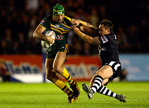 New Zealand's Nathan Fien, right, tackles Australia's Johnathan Thurston, left, during their Four Nations rugby league match at the Stoop Stadium, London, Saturday, Oct. 24, 2009. (AP Photo/Tom Hevezi)