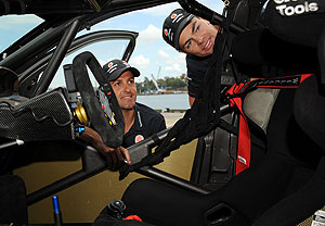 Jamie Whincup (left) and Craig Lowndes pose with a team Ford Falcon in Sydney on Monday, Oct. 6, 2009. AAP Image/Paul Miller