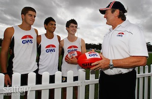 GWS coach Kevin Sheedy addresses players (L-R) Josh Bruce, Tom Kickett and Adam Flagg before a training session at Blacktown Olympic Park, Rooty Hill, NSW.