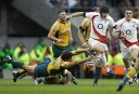 England's Danny Cipriani, right, runs with the ball. AP Photo/Matt Dunham