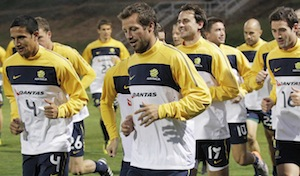 Australia's Tim Cahill left, and captain Lucas Neill, center, lead the team in a warm up run during training at St Stithians College in Johannesburg, South Africa. AP Photo/Rob Griffith.