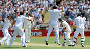 England celebrate as Australia's Xavier Doherty is bowled by England's Graeme Swann. AAP Image/Dean Lewins