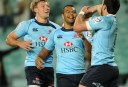 The Waratahs Dave Dennis celebrates his try with teammates Kurtley Beale and Lachie Turner
