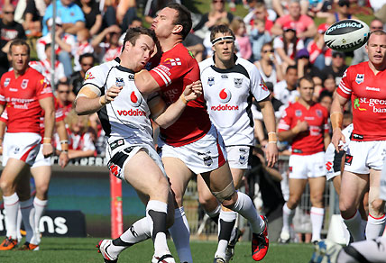 James Maloney hit after getting a kick away during the NRL Round 25. AAP Image/Action Photographics/Grant Trouville