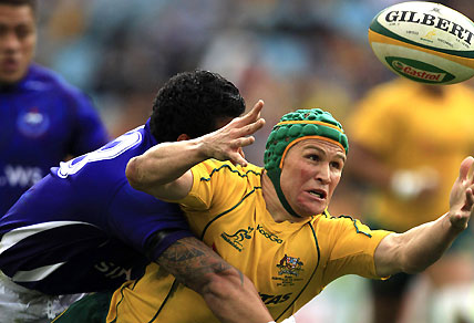 Matt Giteau fails to handle the ball. AP Photo/Rick Rycroft,