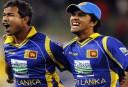 Sri Lankan playersNuwan Kulasekara (left) and Dinesh Chandimal celebrate (AAP Image/Joe Castro)