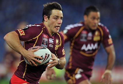 Queensland's Cooper Cronk makes a break. AAP Image/Paul Miller