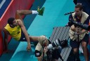 Brazil's Wallace de Souza crashes into the photographers area while competing against Argentina during the men's quarterfinal volleyball match. AFP PHOTO/ MANAN VATSYAYANA