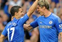 Chelsea's Belgian midfielder Edin Hazard (L) celebrates scoring his penalty with Spanish striker Fernando Torres (R)