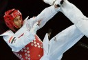 Egypt's Tamer Bayoumi (red) fights against South Korea's Lee Daehoon during their men's taekwondo quarter-final bout in the category under 58 kg. AFP PHOTO / ALBERTO PIZZOLI