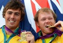 Australia's Iain Jensen (L) and Nathan Outteridge (R) celebrate on the podium after winning gold in the 49er sailing class. AFP PHOTO/William WEST