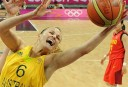 Australian guard Jennifer Screen (R) grabs the ball during the women's quarter final basketball match Australia vs China. Australia won 75 to 60. AFP PHOTO / POOL / MARK RALSTON