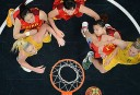 Australia and China's players fight for the ball during the women's quarter final basketball match Australia vs China. AFP PHOTO / ANTONIN THUILLIER