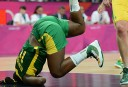 Brazilian centre Clarissa Santos falls during the Women's preliminary round group B basketball match. AFP PHOTO / TIMOTHY A. CLARY