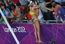 Brazil's Juliana Silva celebrates after winning the women's Beach Volleyball bronze medal match against China's Xue Chen and Zhang Xi. AFP PHOTO / BEN STANSALL
