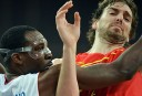 French forward Florent Pietrus (L) vies with Spanish forward Pau Gasol during their men's quarterfinal basketball match. AFP PHOTO /MARK RALSTON