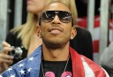 American rapper and actor Ludacris watching the men's basketball preliminary round match Argentina vs USA. AFP PHOTO / MARK RALSTON