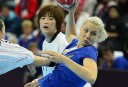 Russia's centreback Tatiana Khmyrova (R) vies with South Korean players during the women's quarter-final handball match. AFP PHOTO/ JAVIER SORIANO