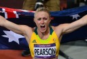 Australia's Sally Pearson celebrates after winning the women's 100m hurdles final. AFP PHOTO / GABRIEL BOUYS