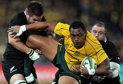 Wallabies' Sekope Kepu is tackled by Richie McCaw and Tony Woodcock. AAP Image/Paul Miller