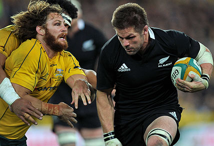 he New Zealand All Black's Richie McCaw gets by Scott Higginbotham of the Wallabies