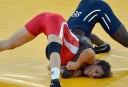 Tunisia's Maroi Mezien (L) wrestles Senegal's Isabelle Sambou in their Women's 48kg Freestyle repechage round 2 match. AFP PHOTO / KHALED DESOUKI