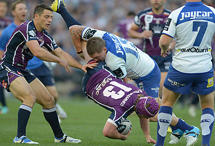 The Canterbury-Bankstown Bulldogs Greg Eastwood tackles the Melbourne Storm's Todd Lowrie during the NRL Grand Final at ANZ Stadium in Sydney, Sunday, Sept. 30, 2012. (AAP Image/Dean Lewins)