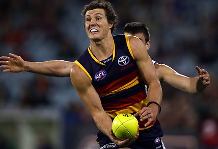 Adelaide Crows' Kurt Tippett handballs the Sherrin