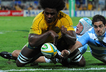 Wallabies player Radike Samo drops the ball on the tryline