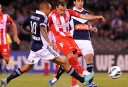 Richard Garcia of Melbourne Heart takes a shot at goals against Archie Thompson of Melbourne Victory