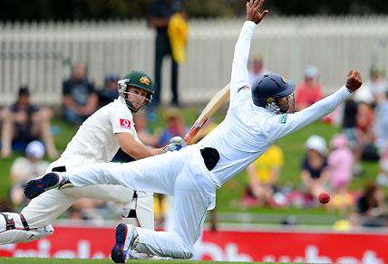 Sri Lanka's Dimuth Karunaratne (R) attempts to catch Australia's batsman Matthew Wade (L)