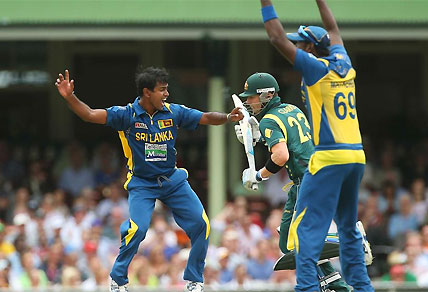 Nuwan Kulasekara of Sri Lanka celebrates claiming the wicket of Australia captain Michael Clarke