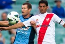 Brett Emerton of Sydney FC contests for the ball with Simon Colosimo of Melbourne Heart.