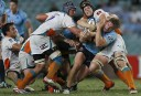 Michael Hooper of the NSW Waratahs amongst heavy Cheetahs defence. (Photo: Paul Barkley/LookPro)