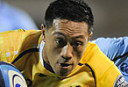 NSW Waratahs' Israel Folau unsuccessfully tries to stop ACT Brumbies' Christian Lealiifano. AAP Image/Lukas Coch